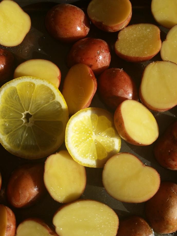 place lemons on top of potatoes before roasting